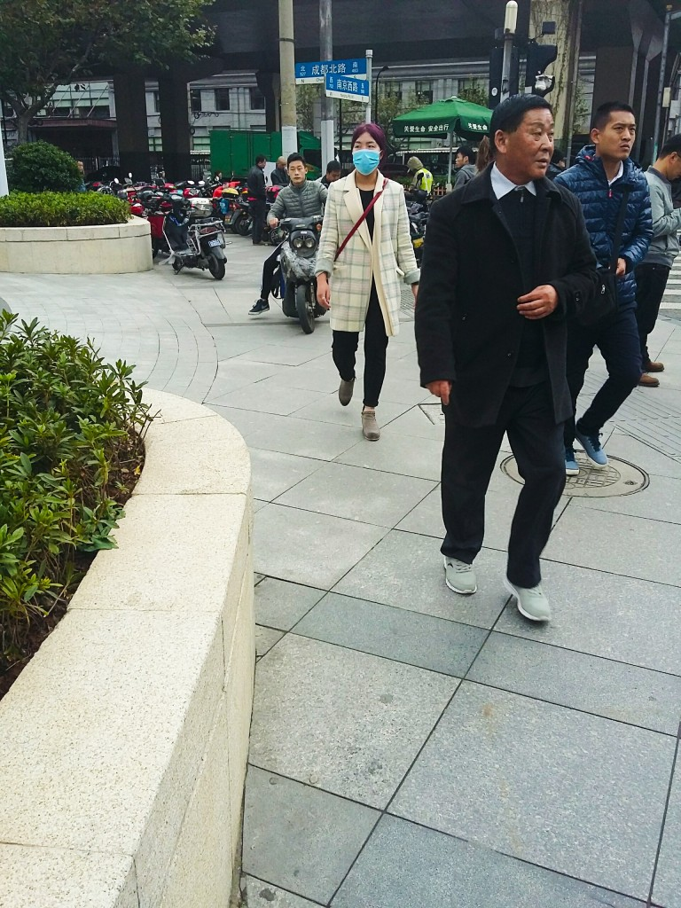 Shanghai pavement-riding scooterist